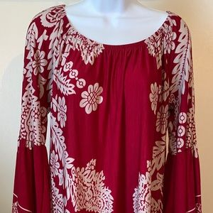 Red tunic with white flowers
